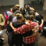 Director Stephanie Tait pulls her cast of award-winning New York City women comedianstogether for a group hug before rehearsal starts.