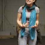 Comedian Katie Sullivan rehearsing for The Naamah'ram Downstairs.