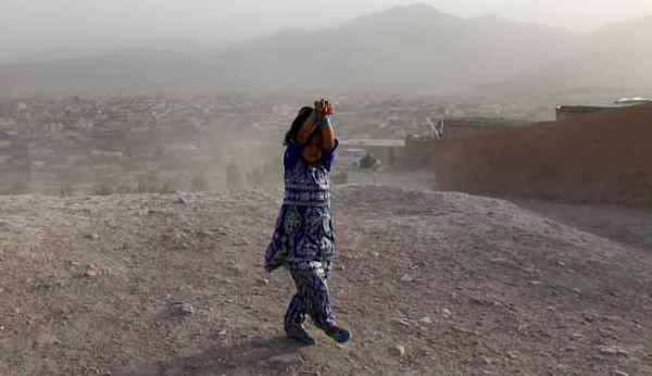 girl in dust storm