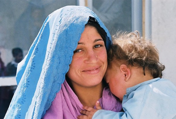 smiling woman with baby