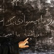 hand on blackboard