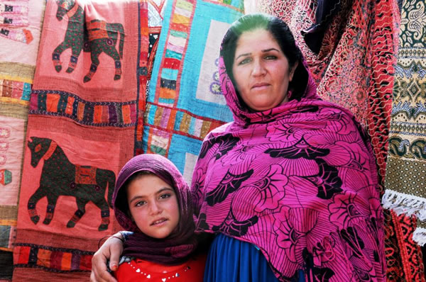 mother and daughter with carpets