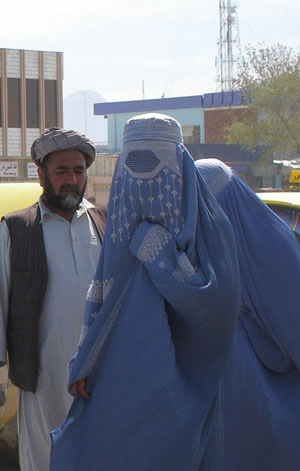 man with two women in burqas
