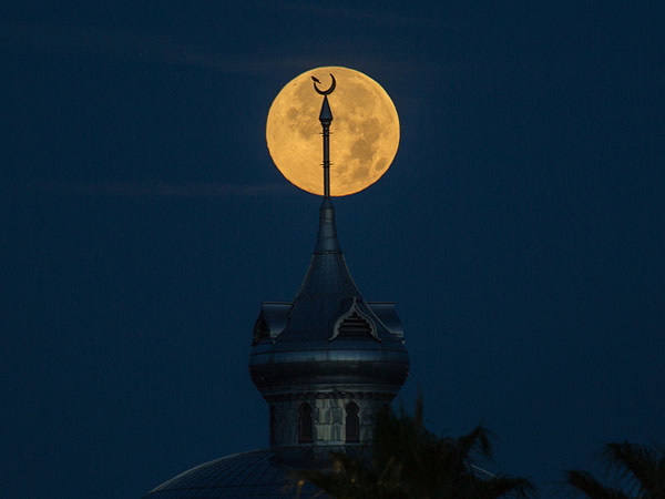 yellow moon and spire