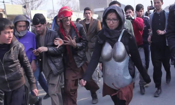 Kabul Artist in Body Armor Makes Street Harassment a Public Issue