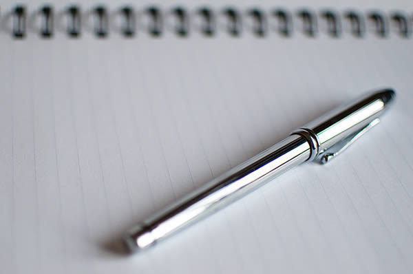silver-pen-and-notebook